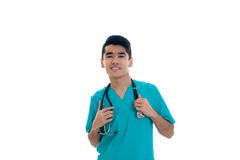 Young beautiful doctor in blue uniform with stethoscope on his neck isolated on white background Royalty Free Stock Photos