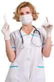 Young and beautiful doctor  in gloves showing ampule Royalty Free Stock Image