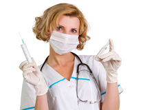 Young and beautiful doctor  in gloves showing ampule Royalty Free Stock Photo
