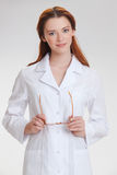 Young beautiful doctorin in the white medicinska coat Stock Photography