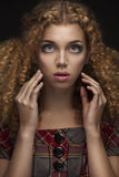 Young beautiful doll girl with curly hair Royalty Free Stock Photo