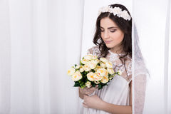 Young beautiful dreaming bride in white dress with flowers Royalty Free Stock Photo