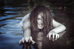 Young beautiful drowned ghost woman in the water Royalty Free Stock Image