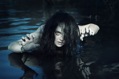 Young beautiful drowned ghost woman in the water Stock Images