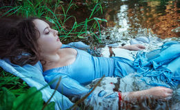 Young beautiful drowned woman lying in the water Royalty Free Stock Photos