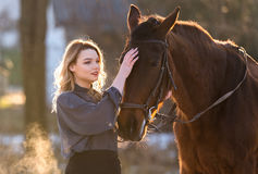 Young beautiful elegance woman posing with horse Royalty Free Stock Image