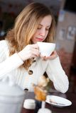 Young beautiful elegant girl drinking coffee or tea Stock Photos