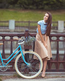 Young beautiful, elegantly dressed woman with bicycle. Beauty, f Royalty Free Stock Photos
