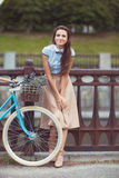 Young beautiful, elegantly dressed woman with bicycle Stock Image