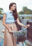 Young beautiful, elegantly dressed woman with bicycle Royalty Free Stock Photos