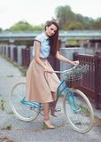 Young beautiful, elegantly dressed woman with bicycle Royalty Free Stock Image