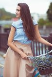 Young beautiful, elegantly dressed woman with bicycle Royalty Free Stock Images