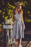 Young beautiful, elegantly dressed woman with Royalty Free Stock Photo
