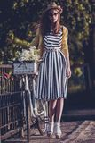 Young beautiful, elegantly dressed woman with Royalty Free Stock Image