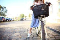 Young beautiful, elegantly dressed woman with bicycle. Beauty, fashion and lifestyle. royalty free stock image