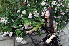 Young beautiful, elegantly dressed woman with bicycle. Healthy, cycling stock photo