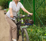 Young, beautiful, elegantly dressed woman with Bicycle. A healthy lifestyle royalty free stock images