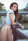 Young beautiful, elegantly dressed woman in the park or outdoor Royalty Free Stock Photo