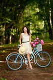 Young beautiful, elegantly dressed woman with retro bicycle. Healthy, cycling. stock image