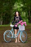 Young beautiful, elegantly dressed woman with retro bicycle. Healthy, cycling. stock photo