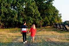 Young beautiful enamored couple walking outdoors in summer at sunset. 1 stock photos