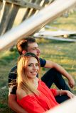 Young beautiful enamored couple walking outdoors in summer at sunset. 1 royalty free stock image
