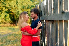 Young beautiful enamored couple walking outdoors in summer at sunset. 1 royalty free stock images