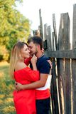 Young beautiful enamored couple walking outdoors in summer at sunset. 1 royalty free stock photo