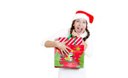 Young beautiful excited happy woman in red christmas hat looking satisfied with present she received Royalty Free Stock Image