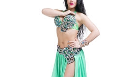Young beautiful exotic eastern women performs belly dance in ethnic green dress. Isolated on white background. Young beautiful exotic eastern woman performs Royalty Free Stock Photography