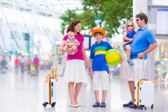 Young beautiful family at the airport Stock Images