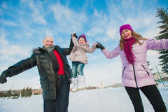 Young beautiful family in bright clothes winter fun sledding, snow, lifestyle, winter holidays Royalty Free Stock Photography