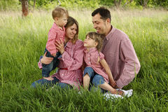 Young beautiful family with children in nature Stock Photo