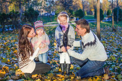 Young beautiful family of four enjoyed relaxing in Royalty Free Stock Photography