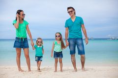 Young beautiful family of four enjoyed relaxing on Stock Images