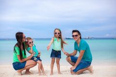 Young beautiful family of four enjoyed relaxing on Royalty Free Stock Photo