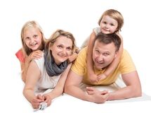 Young beautiful family lying together royalty free stock image
