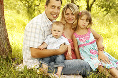 Young beautiful family outdoors Royalty Free Stock Photo