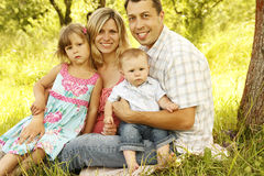 Young beautiful family outdoors Royalty Free Stock Photos