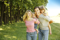 Young beautiful family outdoors Royalty Free Stock Images