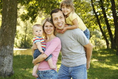 Young beautiful family outdoors Stock Photography