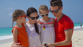 Young beautiful family taking selfie portrait on the beach stock footage