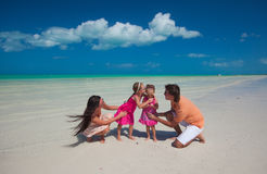 Young beautiful family with two daughters having Stock Images