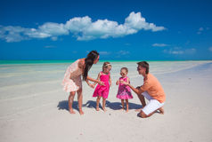 Young beautiful family with two daughters having Royalty Free Stock Photo