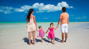 Young beautiful family with two daughters having Royalty Free Stock Photos