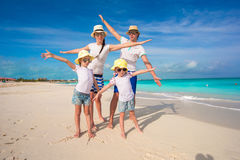 Young beautiful family with two kids on caribbean vacation Royalty Free Stock Photo