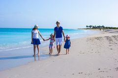 Young beautiful family with two kids on caribbean vacation Royalty Free Stock Image