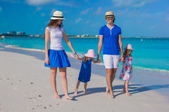 Young beautiful family with two kids on caribbean vacation Stock Photography