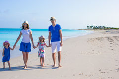 Young beautiful family with two kids on caribbean vacation Stock Photo