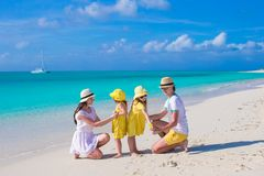Young beautiful family with two kids on caribbean Stock Photos